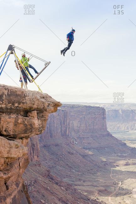 Moab, Utah, USA - November 28, 2015: base jumpers going off at the Turkey Boogie near Moab, Utah