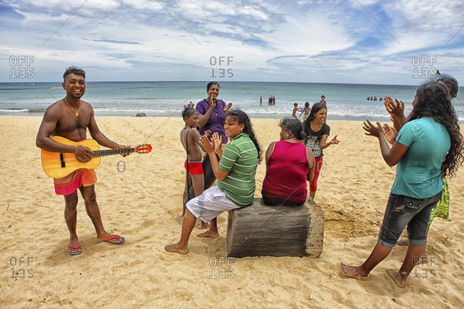 Nilaveli, Trincomalee, Sri Lanka - September 10, 2015: Sri Lankans singing in Nilaveli Beach. Trincomalee. Sri Lanka