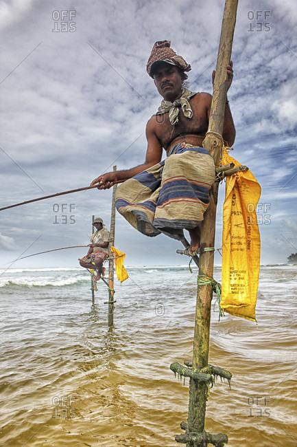 kogalla, kogalla, Sri Lanka - September 21, 2015: Stilt fishermen, Sri Lanka, traditional stilt fisherman at Kogalla, Sri Lanka, Sri Lankan stilt fishing