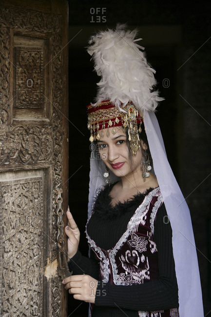 Khiva, Khiva, Uzbekistan - April 3, 2010: Traditionally Dressed Uzbek Woman Performer at the Toshhovli Palace in Khiva Uzbekistan