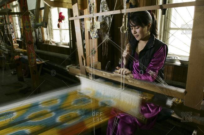 Margilan, Margilan, Uzbekistan - April 11, 2010: Yodgorlik Silk Factory. Traditional methods of silk production