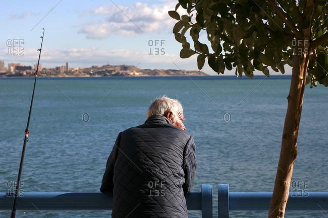 Alicante, Comunidad Valenciana, Spain - December 3, 2005: Man fishing in Alicante