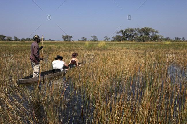 Okavango delta, North-west district, Botswana - August 31, 2010: Botswana, North-west district, Okavango delta, crossing the marshes in mokoro, pirogue