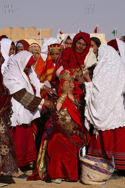 Douz, Tunisia, Tunisia - May 29, 2015: Tunisia Africa North Africa Arabian Arabic Arab Douz town city Sahara festival parade image performance presentation women