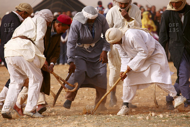Douiret, Tunisia, Tunisia - May 29, 2015: Berber playing with wooden stick costumes, , Douiret, Southern Tunisia, Tunisia, Maghreb, North Africa, Africa