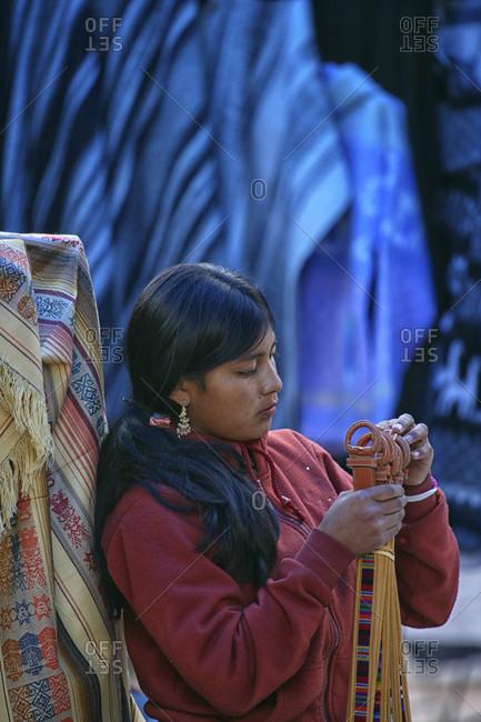 otavalo, Azuay, Ecuador - May 29, 2015: Young Ecuadorian woman on Otavalo Market in Northern Ecuador in South America