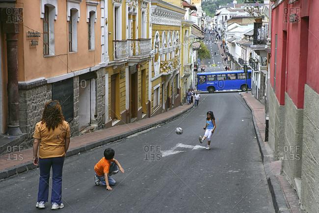 Quito, Quito, Ecuador - May 29, 2015: Kids playing football in the Old Town, Quito, Ecuador
