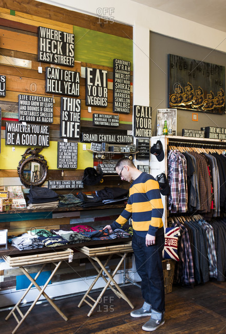 Seattle, Washington, USA - January 23, 2014: A man shops inside a store in Ballard, a neighborhood of Seattle, WA.
