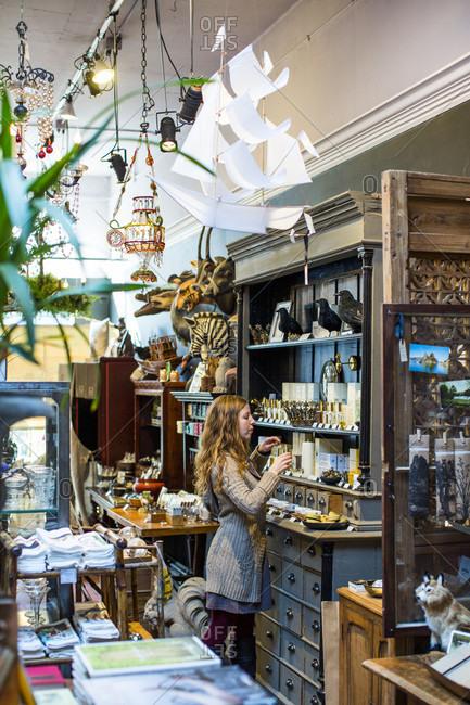 Seattle, Washington, USA - January 23, 2014: A woman shops at a store in Ballard, a neighborhood of Seattle, WA.
