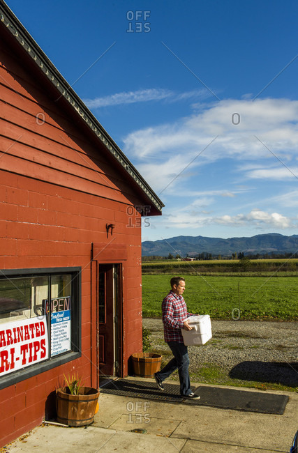 Enumclaw, Washington, USA - October 27, 2014: A man leaves a butcher shop in the small town of Enumclaw, Washington, USA.