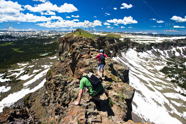 Yampa, Colorado, USA - June 27, 2015: Two hikers going across The Devil's Causeway in Yampa, Colorado.