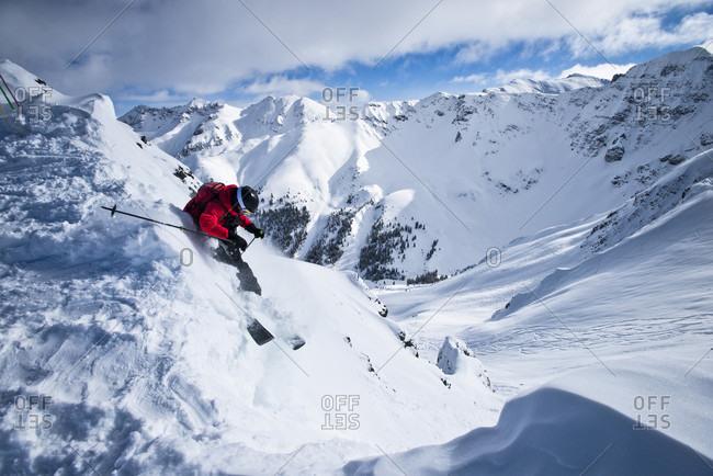 Silverton, Colorado, USA - January 9, 2016: A skier drops in from the top of Silverton Mountain in Colorado.
