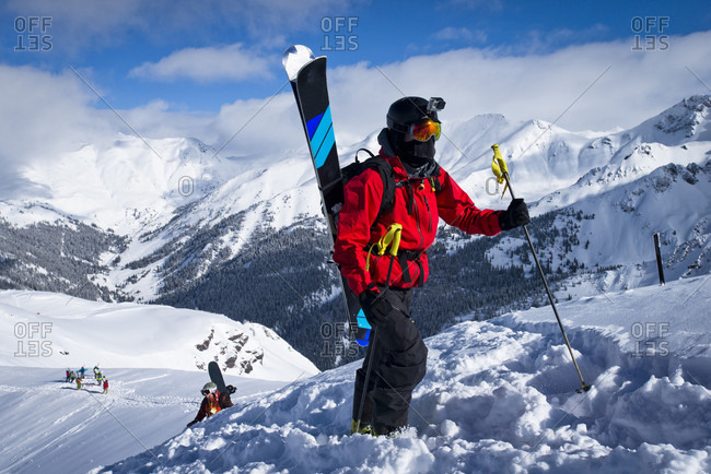 Silverton, Colorado, USA - January 9, 2016: A skier leads his group on a hike up Silverton Mountain in Colorado.