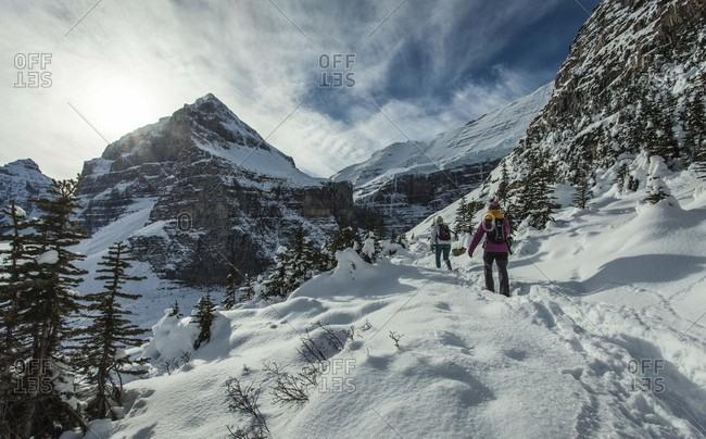 Lake Louise, Alberta, Canada - November 4, 2015: Two women hikers at Lake Louise during a winter hike.