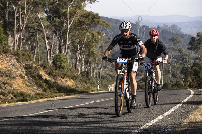 Cradle Mountain, Tasmania, Australia - January 16, 2016: Riders warming up on the road before the start of Wildside MTB 2016 at Cradle Mountain.