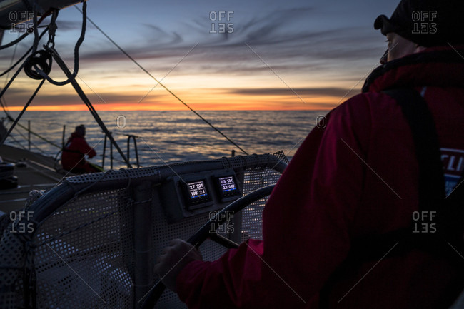 Bass Strait, Tasmania, Australia - December 28, 2015: The sunsets on the horizon during the 3rd day racing in the Rolex Sydney to Hobart 2015, on board Garmin as a part of the Clipper Round the World Yacht Race.