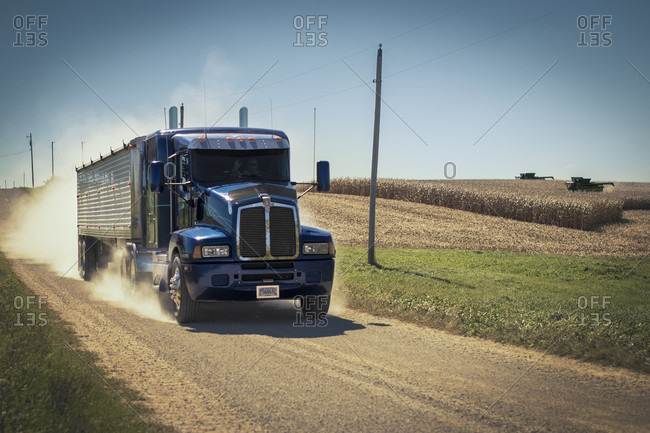 Warren, Illinois, USA - October 2, 2015: Semi hauling corn from field to mill