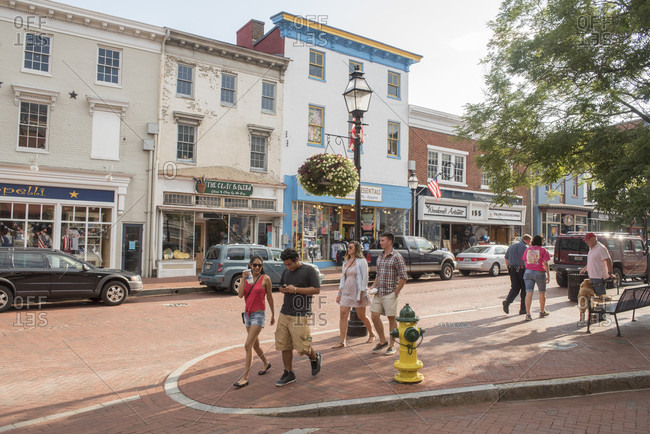 Annapolis, Maryland, United States - July 6, 2015: Pedestrians walk down Main Street in downtown Annapolis, Maryland.