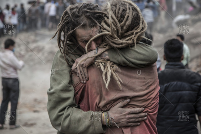 Kathmandu, Bagmati, Nepal - April 25, 2015: Friends reunited in the aftermath of Kastamandap temple collapse where 30 people were crushed including one foreigner.