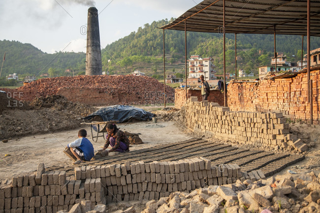 Lele Village, Bagmati, Nepal - May 4, 2015: Making adobe to rebuild houses. Lele Village, 16 Kms from Patan. Nepal. Tears have dried. No time for mourning or waiting for the Aid.