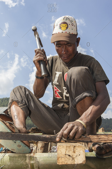 Lele Village, Bagmati, Nepal - May 4, 2015: Houses have fallen down but people are standing tall. Tamang Community of Lele Village helping one another rebuilding houses and restoring lives they lost to cruel earthquake on 25th of April, 2015.