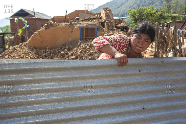 Lele Village, Bagmati, Nepal - May 4, 2015: Houses have fallen down but people are standing tall. Tamang Community of Lele Village helping one another rebuilding houses and restoring lives they lost to cruel earthquake