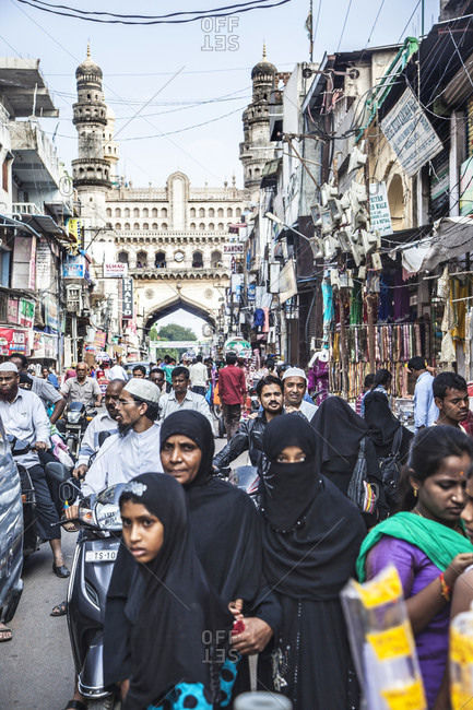 Hyderabad, South India, India - October 18, 2015: Burkha women walk pass busy streets and market near Char Minar in Hyderabad, India,