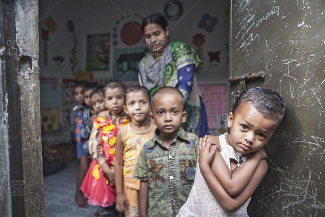 Dhaka, Dhaka, Bangladesh - November 17, 2013: Urban Slum kids go to the Pre-school. Dhaka, Bangladesh. Seen here a students line up.