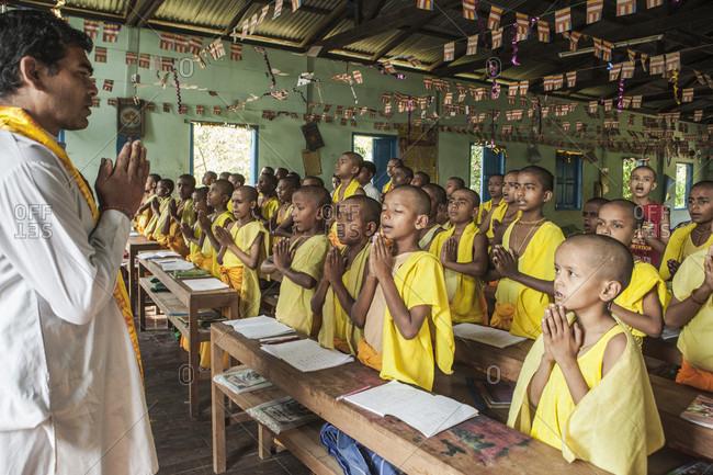 Zyd, Zyd, Myanmar - April 4, 2015: Hindu students start their regular class with prayer at Arya Gurukul. Boys are learning to become Hindu Priest. Myamnar.