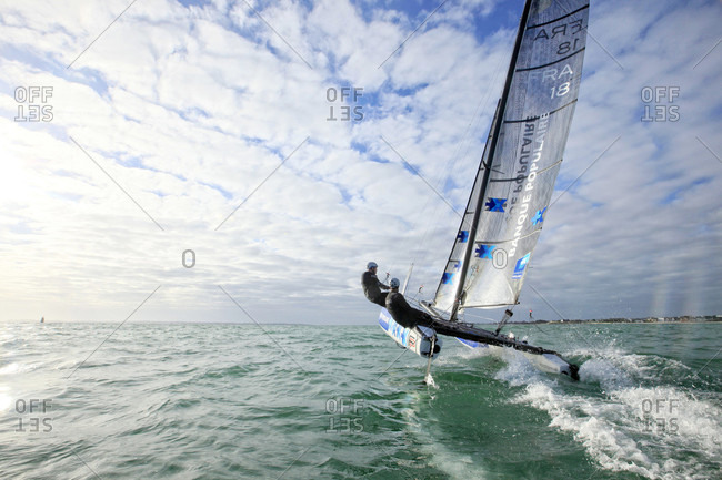 Lorient, Brittany, France - December 10, 2015: Armel Le Cl_ac'h and Kevin Escoffier from the Banque Populaire Sailing Team and the Flying Phantom. The Flying Phantom is a new generation of foiling catamarans design by Martin Fisher.