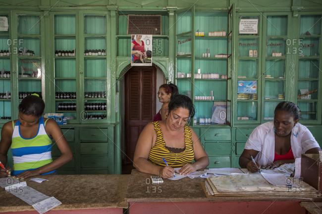 Brasil Pharmacy, Brasil, Cuba - January 15, 2015: Women work in a pharmacy in the small sugar factory town of Brazil, Cuba.