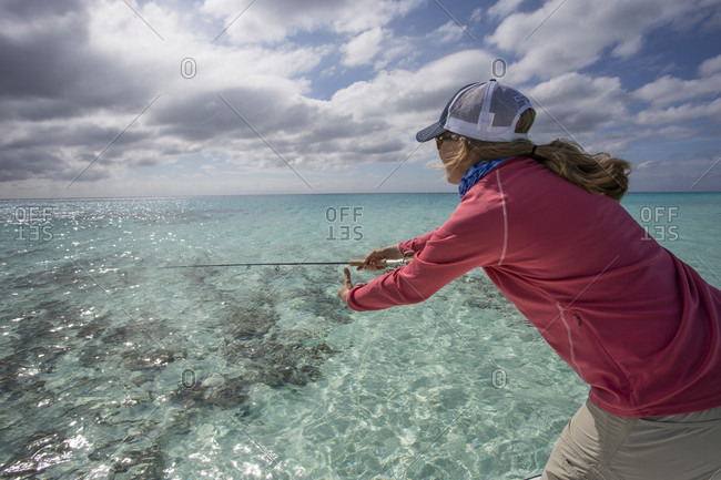 Saltwater, Cayo Largo, Cuba - January 19, 2015: A woman explores the Cayo Largo and Cayo Cruz fisheries. Cuba, January 2016.