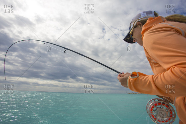 Saltwater, Cayo Largo, Cuba - January 20, 2015: A woman explores the Cayo Largo and Cayo Cruz fisheries. Cuba, January 2016.