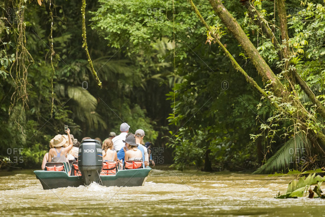 Tortuguero National Park, Costa Rica, Costa Rica - June 18, 2015: Tourists exploring the canals of Tortugaro National Park by boat, Costa Rica