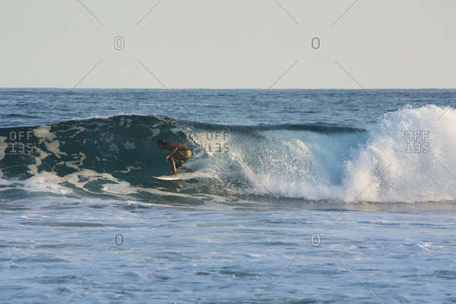 Agua Blanca, Oaxaca, Mexico - July 21, 2015: A young male surfer gets pitted in a 5 fot wave in Agua Blanca, Oaxaca, Mexico.