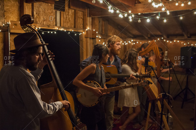 Boulder, Colorado, USA - August 28, 2015: Eric Jones (bass) performs with alt-folk orchestra Patchy Sanders at the Blue Barn in Boulder, Colorado.