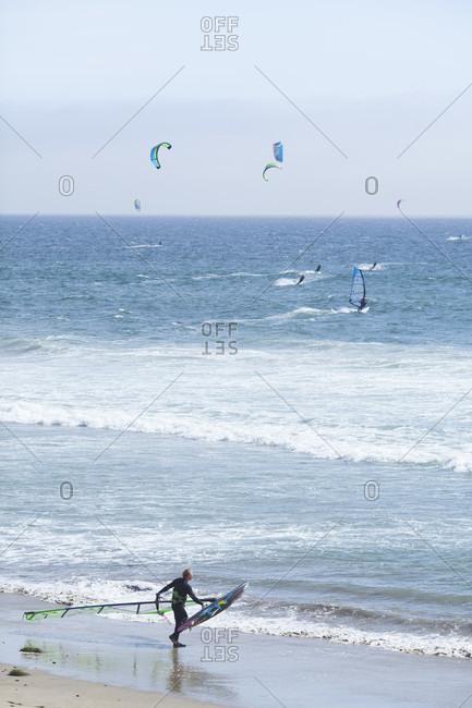 Waddell Creek, California, USA - May 23, 2014: Windsurfing and kiteboarding at Waddell Creek Beach in California, north of Santa Cruz.
