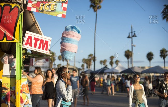 Venice, CA, USA - July 18, 2014: A young woman sells cotton candy on Oceanfront Walk, also known as the Venice Beach Boardwalk