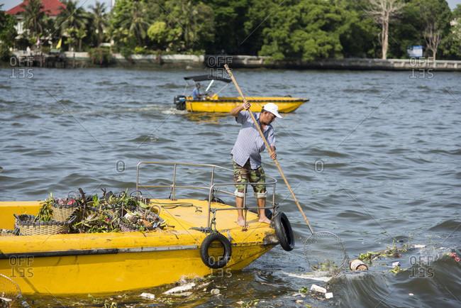 Bangkok, Bangkok, Thailand - May 5, 2015: Workers collect garbage from the Chao Phraya River in Bangkok, Thailand, on May 5, 2015