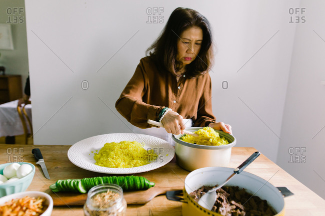 Indonesian woman preparing traditional rice dish