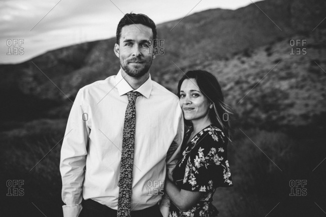 Portrait of man and woman in grassy California hills