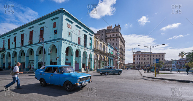 Havana, Cuba - March 7, 2017: Classic cars and old buildings at an intersection