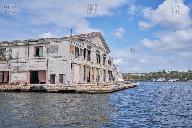 Havana, Cuba - March 7, 2017: Dilapidated historic building on the waterfront