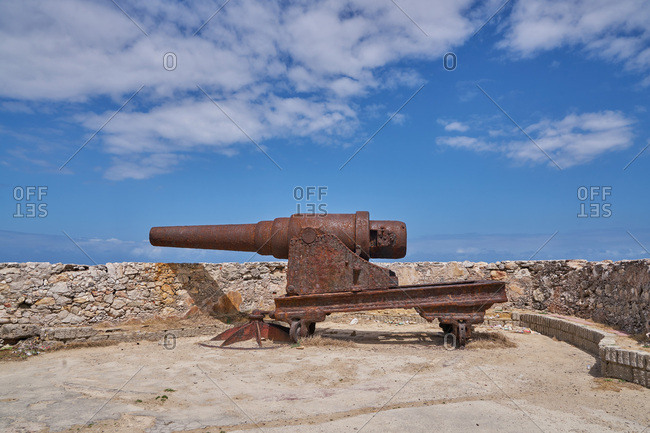 Rusted canon pointing over a fortress wall at Morro Castle, Havana, Cuba