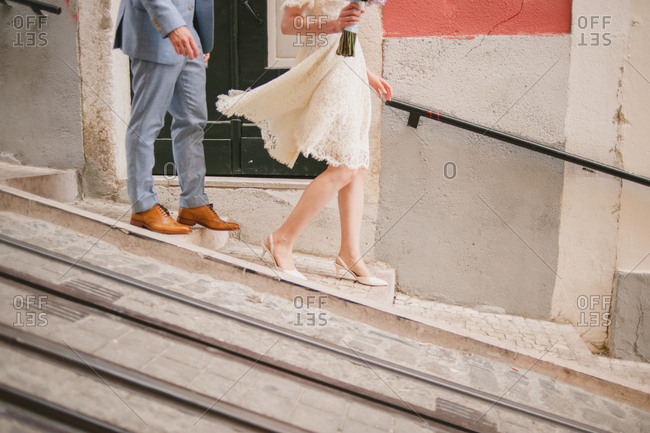 Bride and groom walking in Lisbon