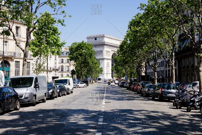Cobblestone street leading to the Arc de Triomphe in Paris, France