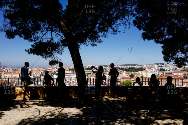 Silhouette of tourists overlooking Lisbon, Portugal
