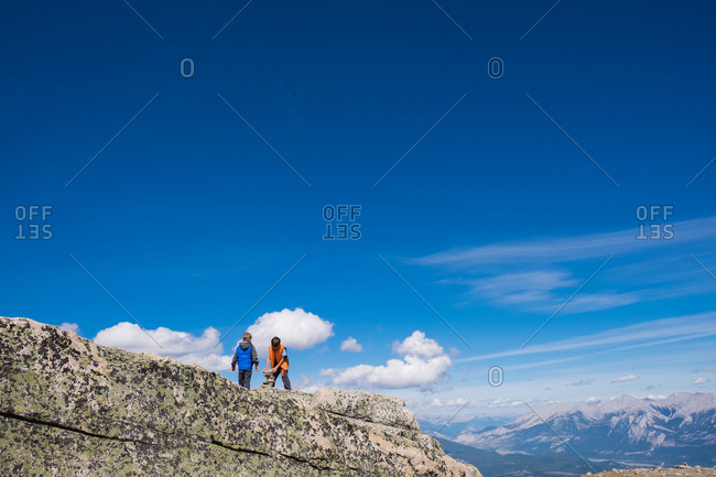 Two boys on mountain peak
