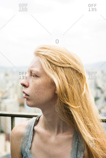 Strawberry blonde woman looking away