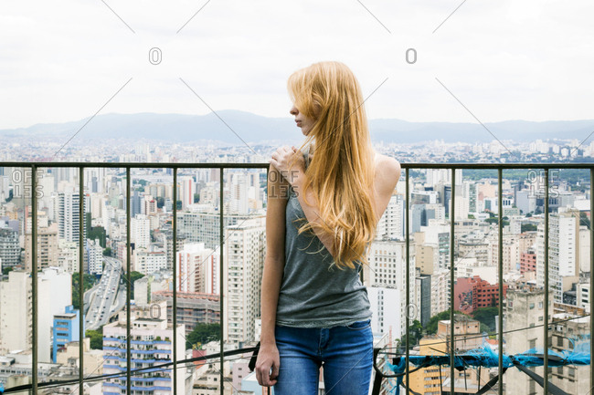 Woman on a rooftop looking away